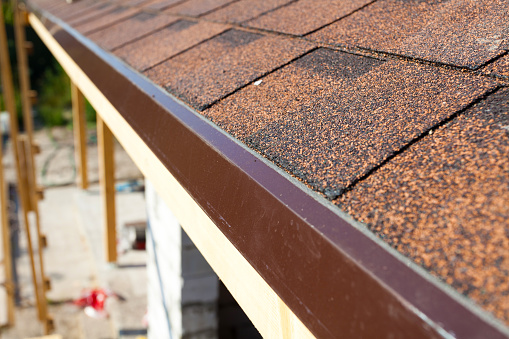 Closeup of new installed bitumen roof shingles.
